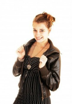 woman in a black leather jacket paired with a dress